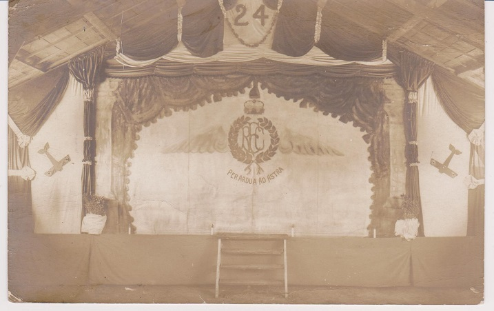 """Original contact print sepia toned photograph of a stage set up with back-drop and curtains noting """"24"""" (Squadron) RFC."""