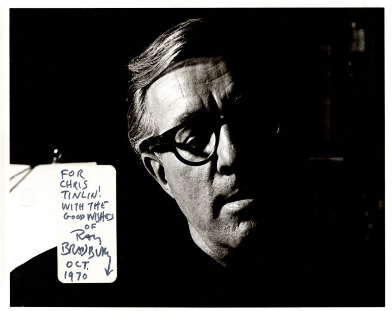 Black and white photographic headshot of Bradbury with a white label applied at lower left-hand corner for his presentation and signature.