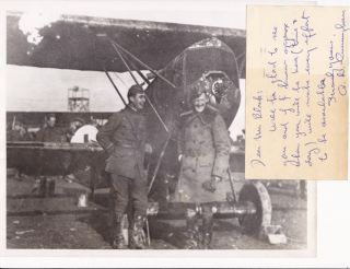 "Photographic copyprint of a war period snapshot, 10"" x 8"", of Cunningham and another man standing..."